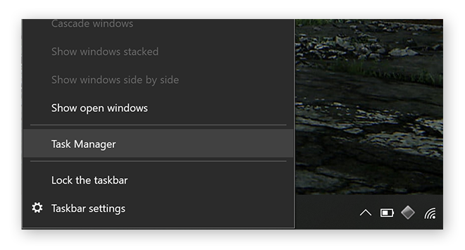 Opening Task Manager from the taskbar on Windows 10.