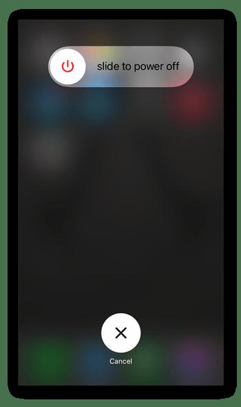 """Veeg langzaam van links naar rechts op de optie """"zet uit"""" om uw iPhone uit te schakelen."""