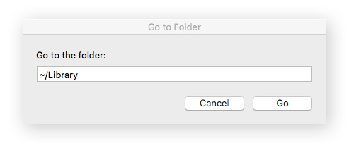 Screenshot of the Go to Folder window, with ~/Library typed in the search bar