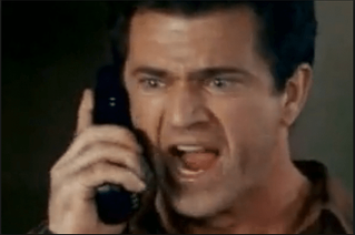 Image of Mel Gibson screaming into a telephone.